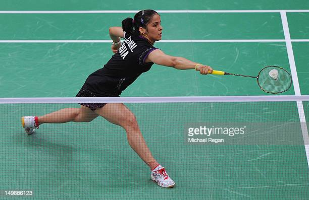 Saina Nehwal of India returns against Tine Baun of Denmark in their Women's Singles Badminton quarter final on day 6 of the London 2012 Olympic Games...