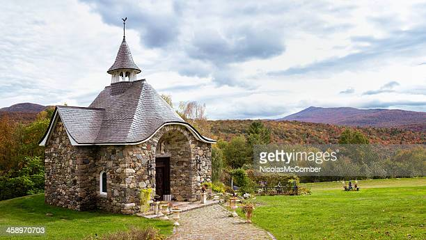 saint agnes vineyard chapel at fall with appalachian mountains - sainte agnès french riviera stock photos and pictures