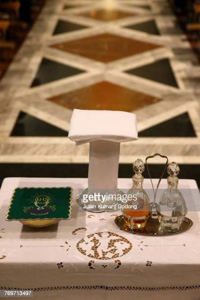 saint alfonsos church, rome. altar with liturgical objects. italy.  - cruet stock photos and pictures