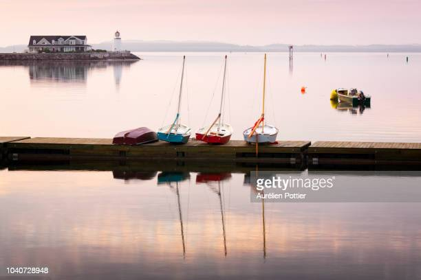 saint andrews, five boats and the lighthouse - moored stock pictures, royalty-free photos & images