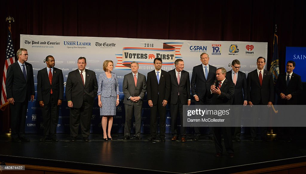 Saint Anselm College President Steven R. DiSalvo introduces (L-R) former Florida Gov. Jeb Bush, Dr. Ben Carson, New Jersey Gov. Chris Christie, former CEO Hewlett-Packard Carly Fiorina, U.S. Senator Lindsey Graham (SC), Louisiana Gov. Bobby Jindal, Ohio Gov. John Kasich, former New York Gov. George Pataki, former Texas Gov. Rick Perry, former U.S. Senator Rick Santorum (PA), Wisconsin Gov. Scott Walker stand on the stage prior to the Voters First Presidential Forum at Saint Anselm College August 3, 2015 in Manchester, New Hampshire. The forum was organized by the New Hampshire Union Leader newspaper and C-SPAN in response to the Fox News debate later this week that will limit the candidates to the top 10 Republicans based on nationwide polls.