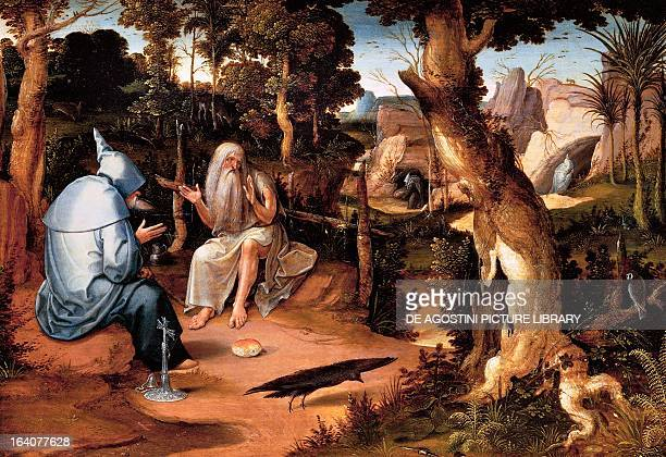 Saint Anthony the Great with Saint Paul the Hermit in a wooded landscape by Jan Wellens de Cock