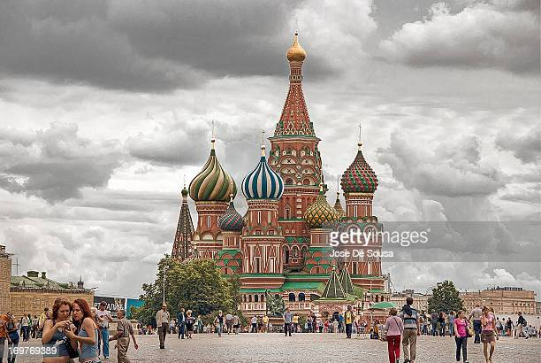 CONTENT] Saint Basil's Cathedral in Moscow's Red Square under a cloudy sky with people diverse activities