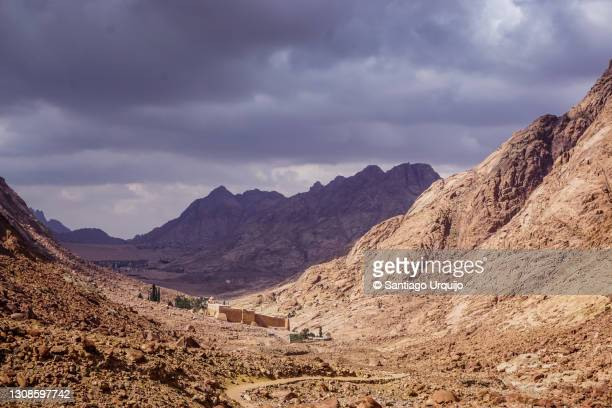 saint catherine's monastery under a stormy sky - tourism in south sinai stock pictures, royalty-free photos & images