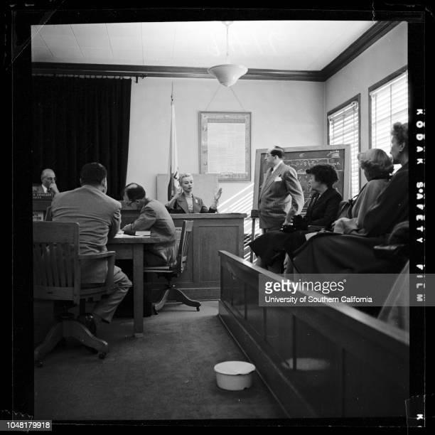 Saint Cyr casecandid shots 7 December 1951 Lili Saint CyrAttorney Jerry GieslerBernard Gross Deputy District AttorneyCaption slip reads 'Photographer...