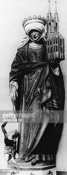 Saint Elizabeth Middle Ages St. Elizabeth 1207 - 1231 wife of landgrave Louis of Thuringia painted wooden statue at Elizabeth Church, Marburg - 13th...