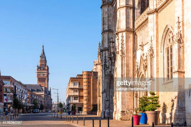saint eloi church and the city hall tower in dunkirk, france - dunkirk evacuation stock pictures, royalty-free photos & images