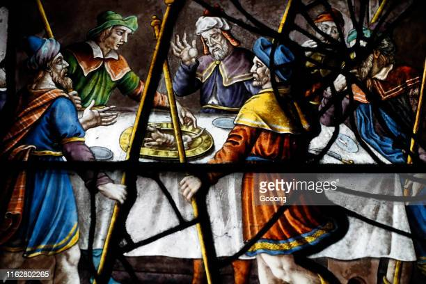 Saint Etienne du Mont church. Stained glass window. The jewish Passover with the hebrews standing round a table with the Paschal lamb. Paris. France.