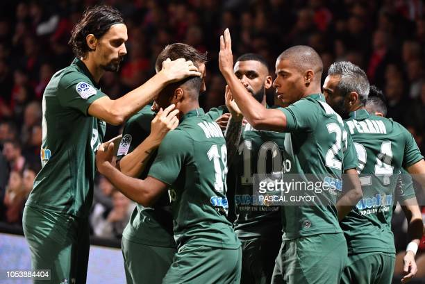Saint Etienne players jubilate after scoring a goal during the French L1 football match between Nimes and SaintEtienne on October 26 2018 at the...
