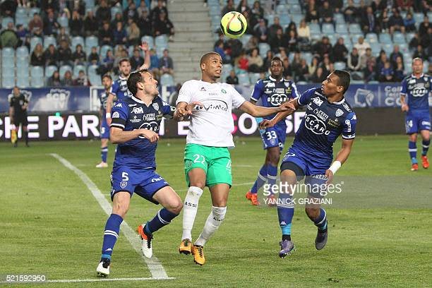 Saint Etienne's French forward Kevin MonnetPaquet vies with Bastia's French defender Sébastien Squillaci and Bastia's French defender Alexander Djiku...