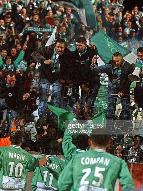Saint Etienne's players celebrate wth their supporters after winning their French second League football match against Niort 07 May 2004 at stade...