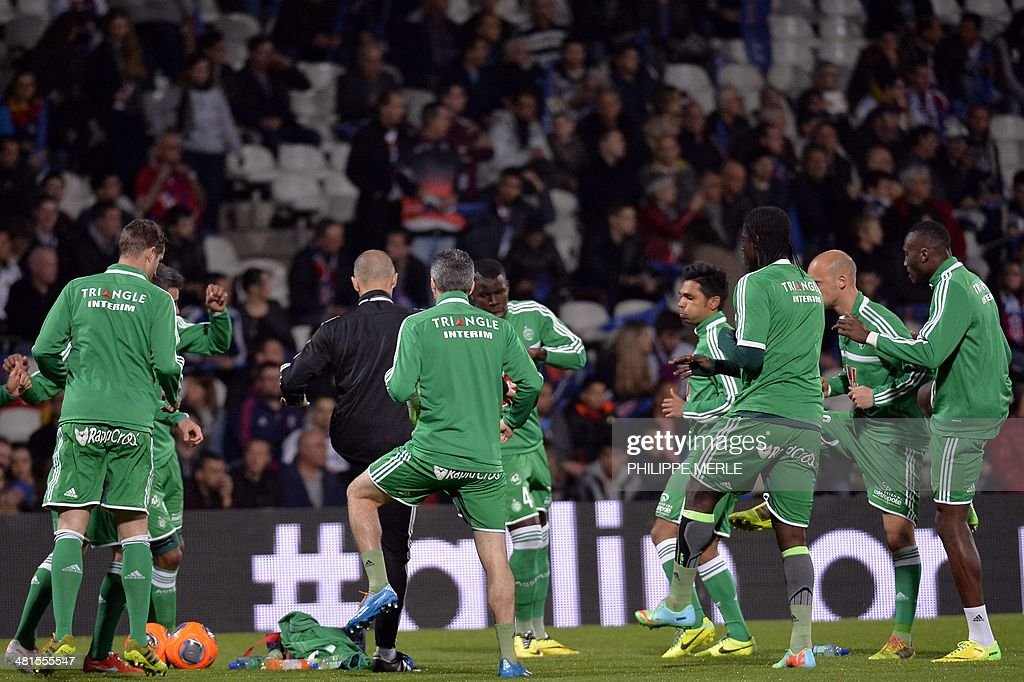 Saint Etienne's players warm up prior to the French L1 football match Lyon (OL) vs saint Etienne (ASSE) on March 30, 2014 at the Gerland stadium in Lyon, central eastern France.
