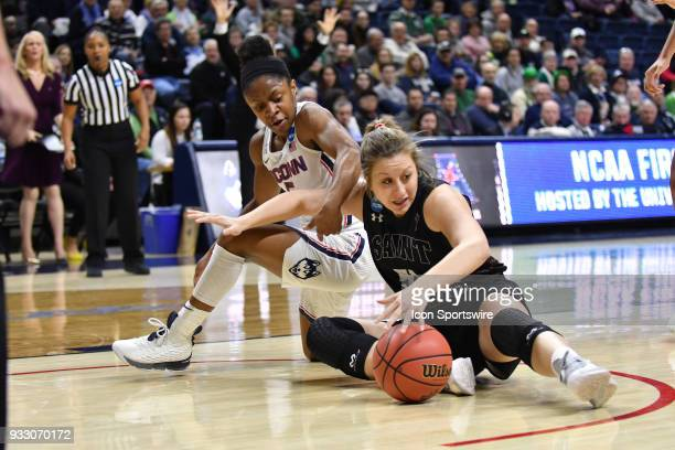 Saint Francis Red Flash Guard / Forward Haley Thomas and UConn Huskies Guard Crystal Dangerfield battle for the loose ball during the game as the...