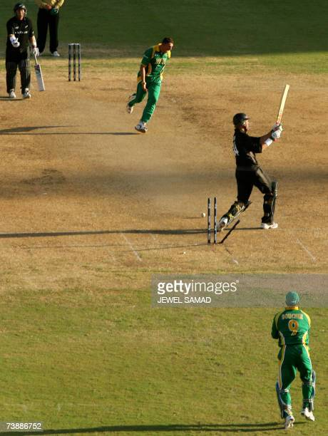 Saint George's, GRENADA: New Zealand's cricketer Jacob Oram is clean bowled off South African bowler Andre Nel during the ICC World Cup Cricket 2007...
