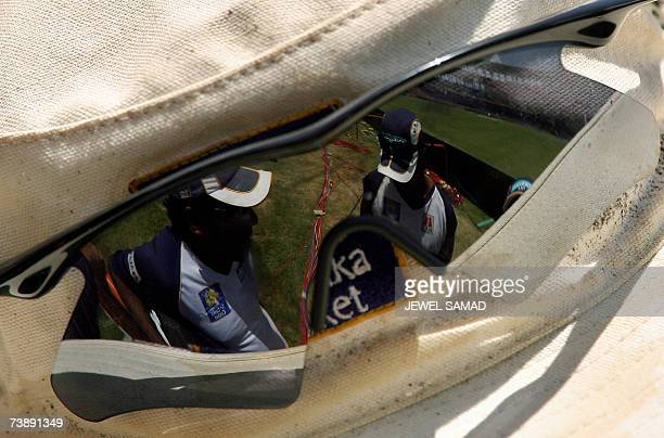 Saint George's GRENADA Sri Lankan cricket team captain Mahela Jayawardene and his teammate are reflected on the sunglasses of coach Tom Moody as they...