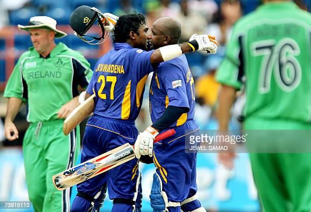 Saint George's GRENADA Sri Lankan cricket team captain Mahela Jayawardene and batsman Sanath Jayasuriya embrace each other following their victory...