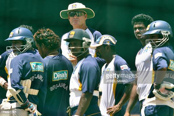 Saint George's GRENADA Sri Lankan cricket team coach Tom Moody confers with his team members during a practice session at the Grenada National...