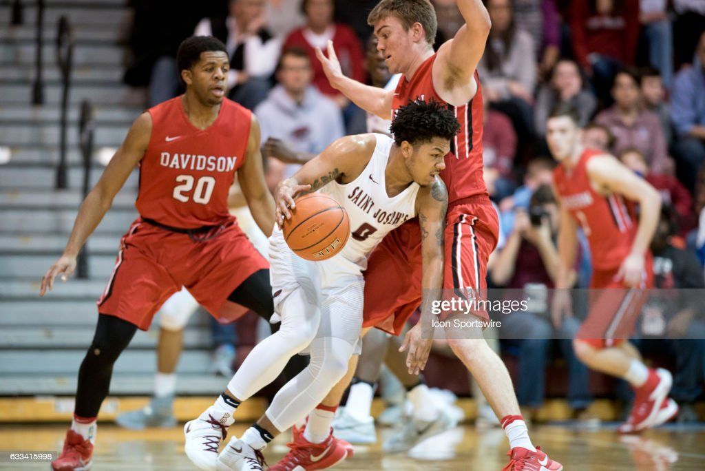 Saint Joe's Guard Lamarr Kimble (0) collides with Davidson Forward Petyon Aldridge (23) in the first half during the game between the Davidson College Wildcats and Saint Joseph's University Hawks on January 31, 2017 at Hagan Arena in Philadelphia, PA.