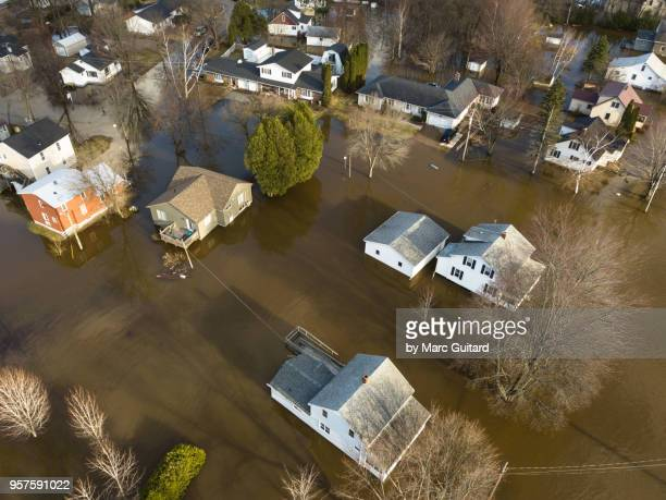 saint john river flooding at barker's point in the spring of 2018 in fredericton, new brunswick, canada - flooding stock photos and pictures