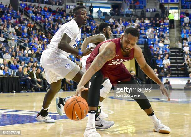 Saint Joseph's forward Jai Williams tries to hang on to a loose ball during an Atlantic 10 Conference basketball game between the Saint Joseph's...