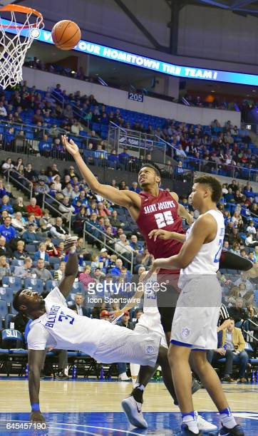 Saint Joseph's forward James Demery charges in to Saint Louis Billikens forward Reggie Agbeko during an Atlantic 10 Conference basketball game...