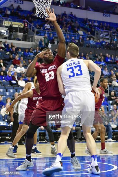 Saint Joseph's forward Markell Lodge tries to block out Saint Louis Billikens forward Elliott Welmer during an Atlantic 10 Conference basketball game...