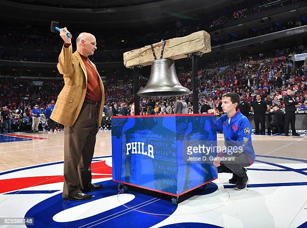Saint Josephs Head Coach Phil Martelli rings the liberty bell prior to the game against the Memphis Grizzlies at Wells Fargo Center on November 23...