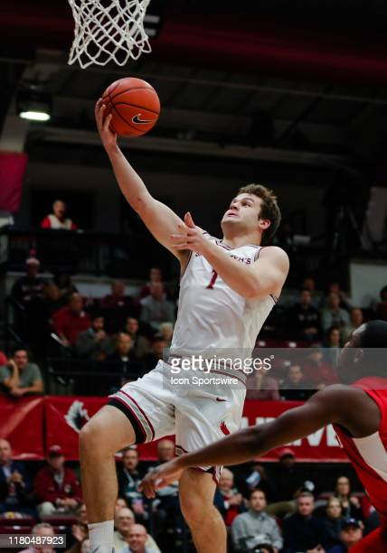Saint Josephs University guard Ryan Daly soars through the air for an easy layup during the game between Bradley University and Saint Josephs...