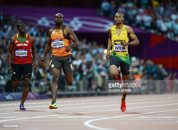 Saint Kitts Nevis' Antoine Adams The Netherland's Churandy Martina and Jamaica's Warren Weir compete in the men's 200m semifinals at the athletics...