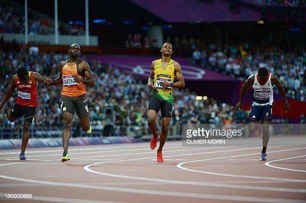 Saint Kitts Nevis' Antoine Adams The Netherland's Churandy Martina Jamaica's Warren Weir and Britain's Christian Malcolm compete in the men's 200m...