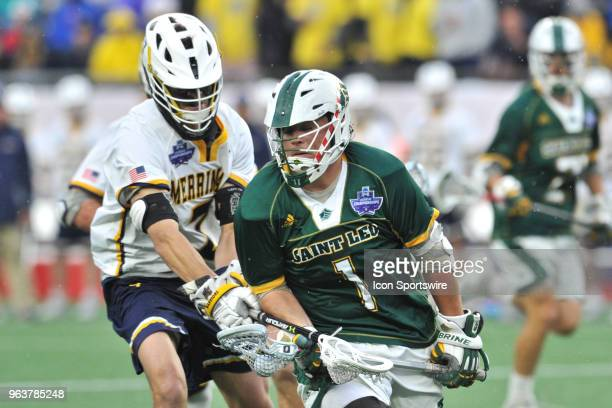 Saint Leo University Jordan Williams get she ball knocked out of his hand by Merrimack College Hunter Schmell During the Saint Leo Lions game against...