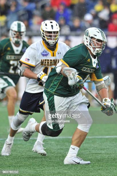 Saint Leo University Jordan Williams makes his way up field with the ball During the Saint Leo Lions game against Merrimack Warriors at Gillette...