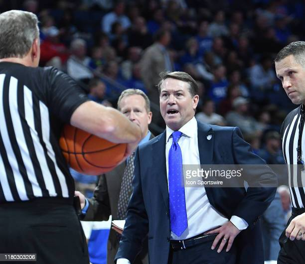 Saint Louis basketball coach Travis Ford talks to an official about a call during a time out during a non conference basketball game between the...