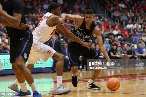 Saint Louis Billikens forward Jalen Johnson drives past Dayton Flyers forward Kostas Antetokounmpo in a game between the Dayton Flyers and the Saint...