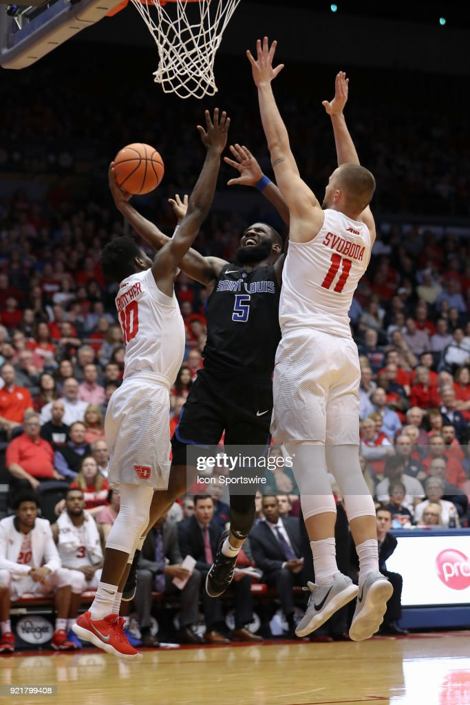 Saint Louis Billikens guard Davell Roby (5) attempts a layup in between Dayton Flyers guard Jalen Crutcher (10) and Dayton Flyers forward Matej Svoboda (11) in a game between the Dayton Flyers and the Saint Louis Billikens on February 20, 2018 at University of Dayton Arena in Dayton, OH.