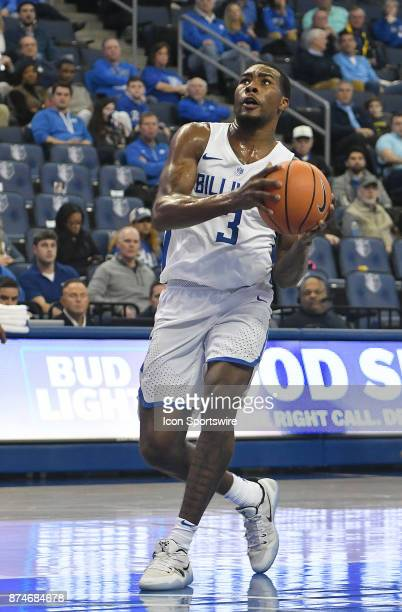 Saint Louis Billikens guard Javon Bess drives in for a jump shot during a non conference basketball game between the Rockhurst Hawks and the Saint...