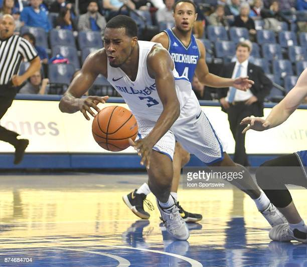 Saint Louis Billikens guard Javon Bess falls on the court as he tries to shoot during a non conference basketball game between the Rockhurst Hawks...