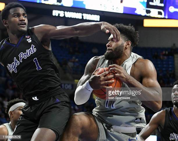 Saint Louis forward Hasahn French holds on to a rebound as High Point Panthers guard JohnMichael Wright defends during a nonconference college...
