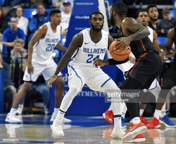 Saint Louis guard Aaron Hines guards Houston Cougars guard Armoni Brooks in the first half during a nonconference college basketball game beween the...