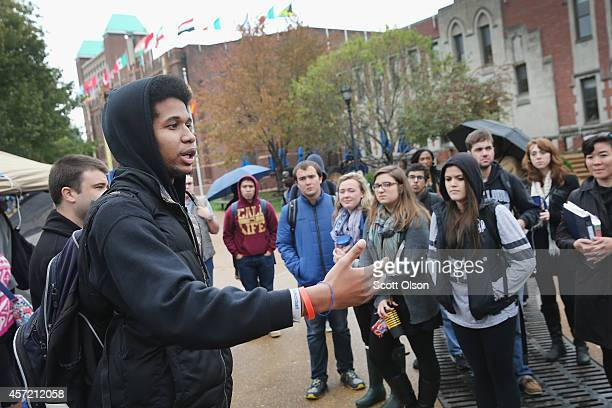 Saint Louis University student Jonathan Pulphus speaks to other students about racial injustice at a small camp on the university campus on October...