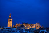 Saint Mary of the See largest cathedral in the world in, Spain at dusk with lights
