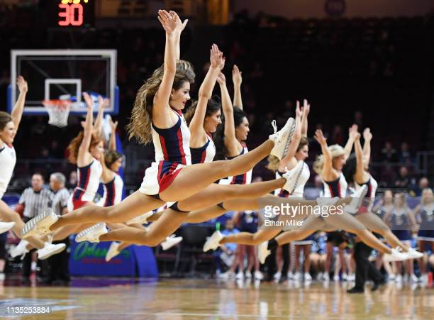 Saint Mary's Gaels cheerleaders perform during a semifinal game of the West Coast Conference basketball tournament against the San Diego Toreros at...