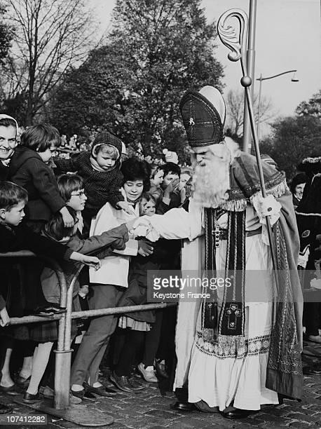 Saint Nicholas Giving Presents To Children In Rotterdam On November 15Th 1952