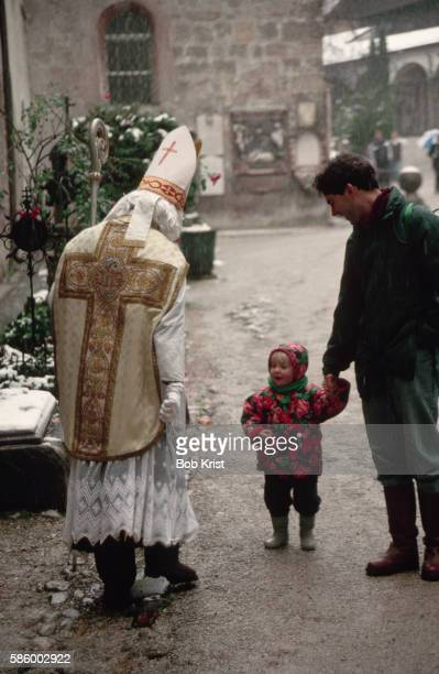 Saint Nicholas Talking With Young Child