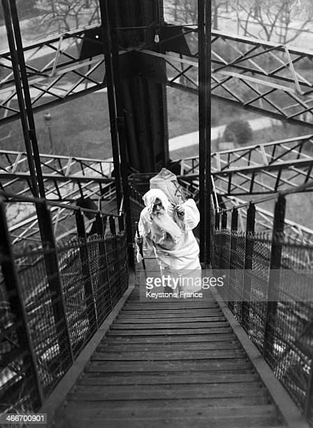 Saint Nicholas with his bag at the Eiffel Tower on Saint Nicholas Day in December 1929 in Paris France