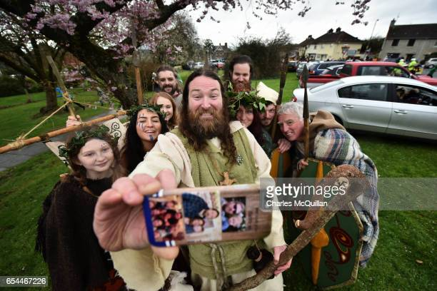 Saint Patrick played by actor Marty Burns takes a selfie along with members of the Magnus Vikings Association before they part in the cross community...