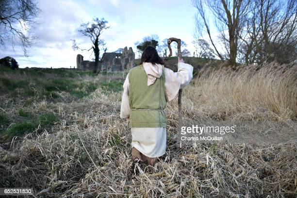 Saint Patrick played by Marty Burns looks to the remains of Inch Abbey as the reenactment of the first landing of Saint Patrick in Ireland takes...