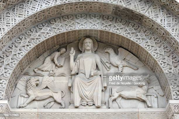 Saint Paul church. The four winged creatures that symbolise the Four Evangelists surround Christ in Majesty. Geneva. Switzerland.