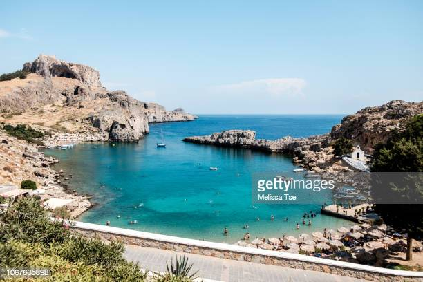 saint paul's bay in lindos, greece - lindos stock photos and pictures