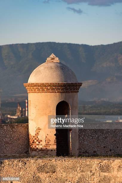 Saint Peter of the Rock castle A white brick watchtower on a stone wall with a scenic background El Morro de Santiago de Cuba is a Unesco World...
